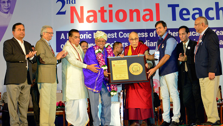 His Holiness the Dalai Lama presenting the Jeevan Gaurav Puraskar Awards at the 2nd National Teachers' Congress Inaugural Ceremony in Pune, Maharashtra, India on January 10, 2018. Photo by Lobsang Tsering