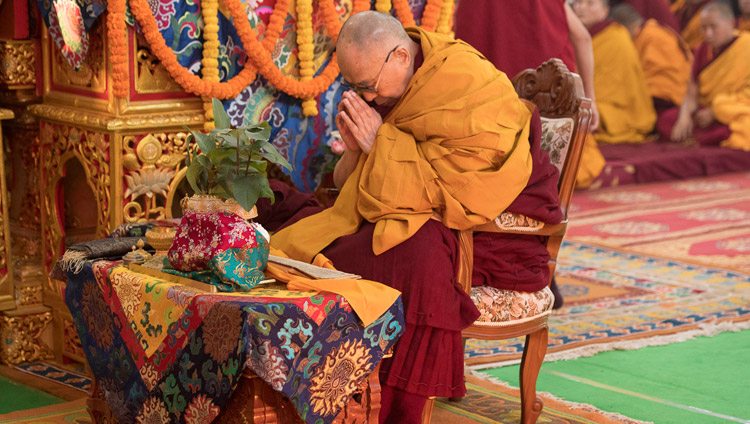 His Holiness the Dalai Lama performing preliminary procedures to prepare himself to grant an Avalokiteshvara empowerment on the second day of his teachings in Bodhgaya, Bihar, India on January 15, 2018. Photo by Manuel Bauer