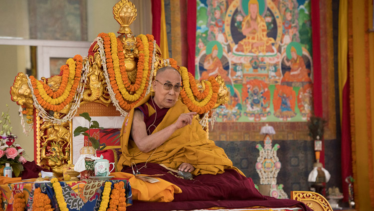 His Holiness the Dalai Lama addressing the crowd at the start of the Avalokiteshvara Empowerment in Bodhgaya, Bihar, India on January 16, 2018. Photo by Manuel Bauer