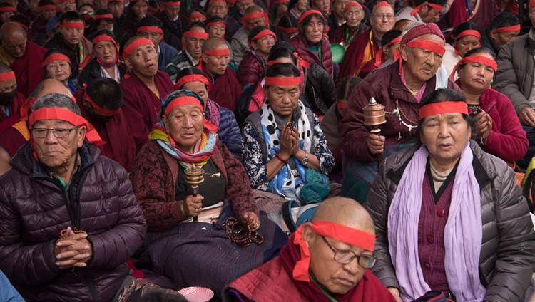 Members of the audience wearing ritual blindfolds listening to His Holiness the Dalai Lama during the Avalokiteshvara Empowerment in Bodhgaya, Bihar, India on January 16, 2018. Photo by Manuel Bauer