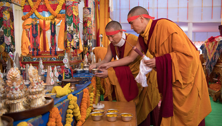 Monks assisting His Holiness the Dalai Lama during the Avalokiteshvara Empowerment in Bodhgaya, Bihar, India on January 16, 2018. Photo by Manuel Bauer