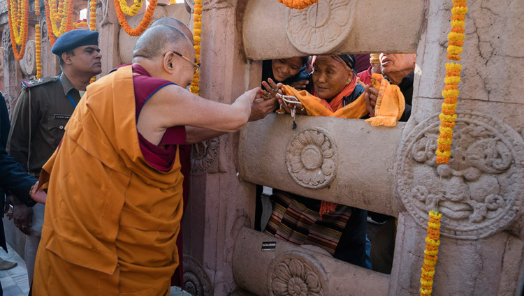 His Holiness the Dalai Lama greeting pilgrims during his visit to the Mahabodhi Stupa in Bodhgaya, Bihar, India on January 28, 2018. Photo by Tenzin Choejor