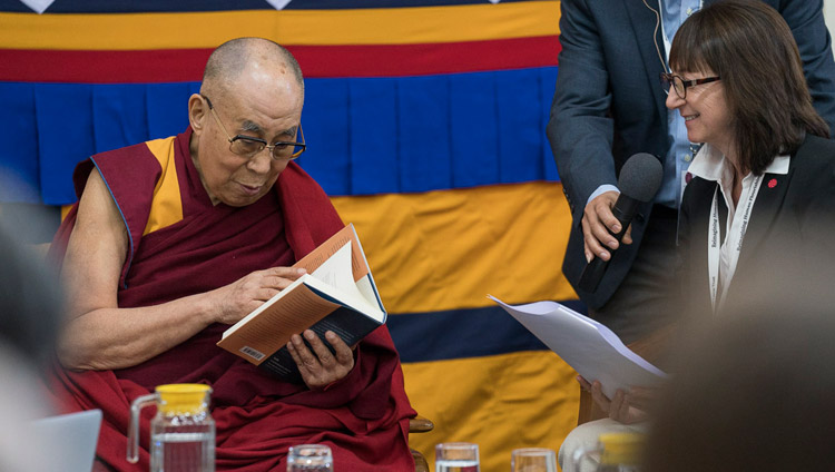 Susan Bauer-Wu, President of the Mind & Life Institute, presenting His His Holiness the Dalai Lama with a copy of 'The Monastery and The Microscope', a record of the dialogue that took place in Mundgod in 2013 on the opening day of the 33rd Mind & Life Conference in Dharamsala, HP, India on March 12, 2018. Photo by Tenzin Choejor
