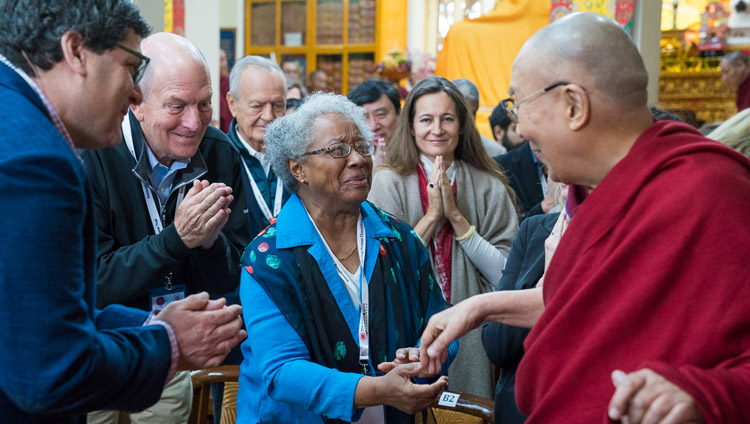 His Holiness the Dalai Lama greeting members of the audience as he arrives for the fourth day of the Mind & Life Conference at the Main Tibetan Temple in Dharamsala, HP, India on March 15, 2018. Photo by Tenzin Choejor