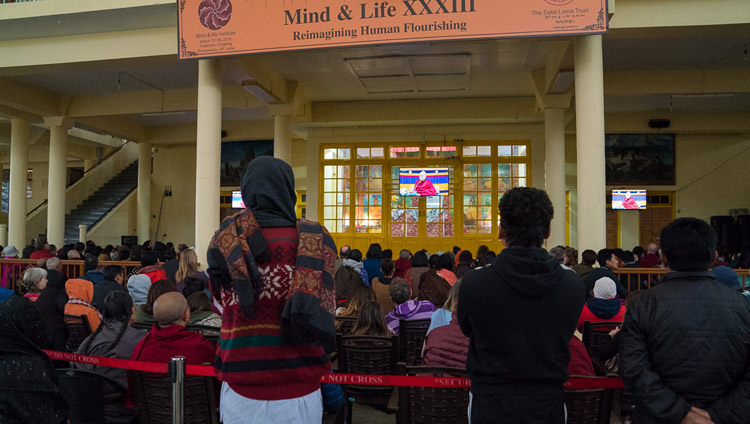 Members of the public watching His Holiness the Dalai Lama on TVs in the courtyard of the Main Tibetan Temple on the fourth day of the Mind & Life Conference in Dharamsala, HP, India on March 15, 2018. Photo by Tenzin Choejor