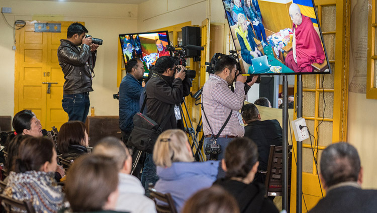 Members of the press photographing the proceedings on the final day of the Mind & Life Conference at the Main Tibetan Temple in Dharamsala, HP, India on March 16, 2018. Photo by Tenzin Choejor