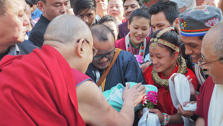 A couple presenting their new born baby to His Holiness the Dalai Lama for a blessing as he arrives at the Central Institute for Higher Tibetan Studies (CIHTS) in Sarnath, UP, India on March 19, 2018. Photo by Jeremy Russell