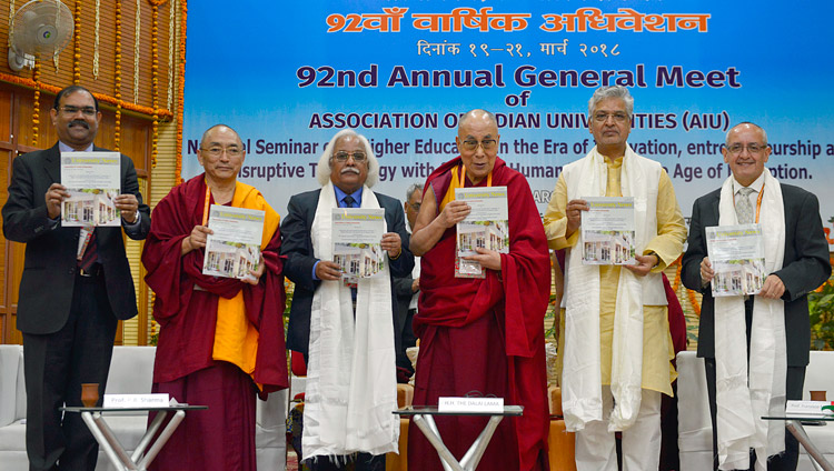 His Holiness the Dalai Lama and participants releasing the AIU Annual Report at the 92nd Annual Meet of Association of Indian Universities at CIHTS in Sarnath, UP, India on March 19, 2018. Photo by Lobsang Tsering