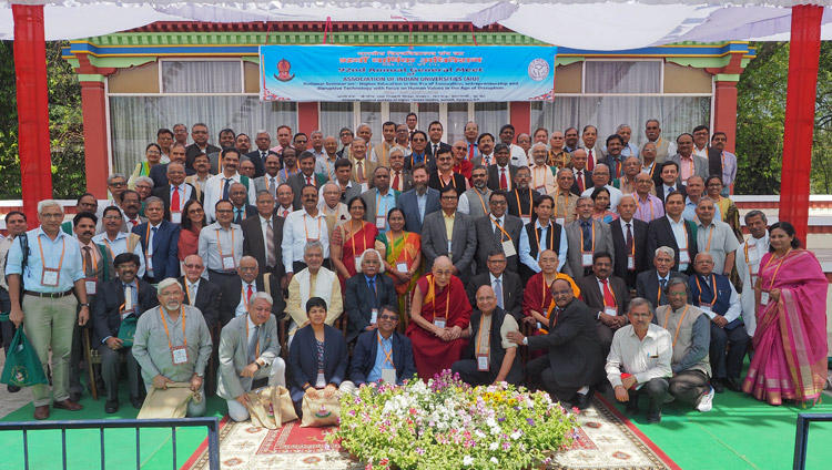 His Holiness the Dalai Lama joins the Vice Chancellors attending the 92nd Annual Meet of Association of Indian Universities after the conclusion of the inaugural session at CIHTS in Sarnath, UP, India on March 19, 2018. Photo by Jeremy Russell