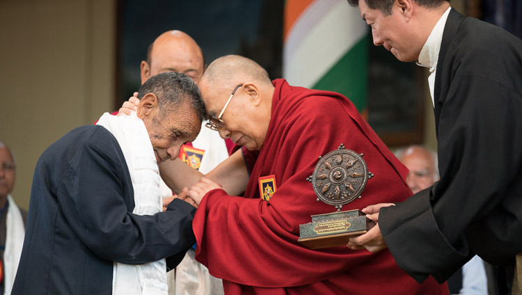 His Holiness the Dalai Lama embracing Naren Chandra Das, the sole known survivor of the seven Assam Rifles personnel who received him at the Indian border in 1959, during the Thank You India celebrations in Dharamsala, HP, India on March 31, 2018. Photo by Tenzin Choejor