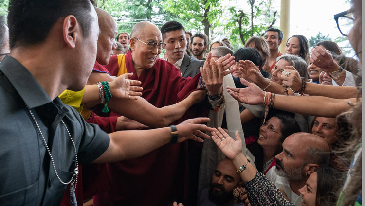 His Holiness the Dalai Lama greeting members of the more than 1500 strong crowd gathered in the Main Tibetan Temple courtyard to listen to his talk in Dharamsala, HP, India on April 16, 2018. Photo by Tenzin Choejor