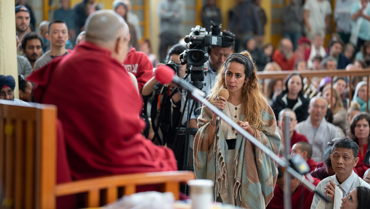 A member of the audience asking His Holiness the Dalai Lama a question during his talk to visitors from India and abroad at the Main Tibetan Temple courtyard in Dharamsala, HP, India on April 16, 2018. Photo by Tenzin Choejor