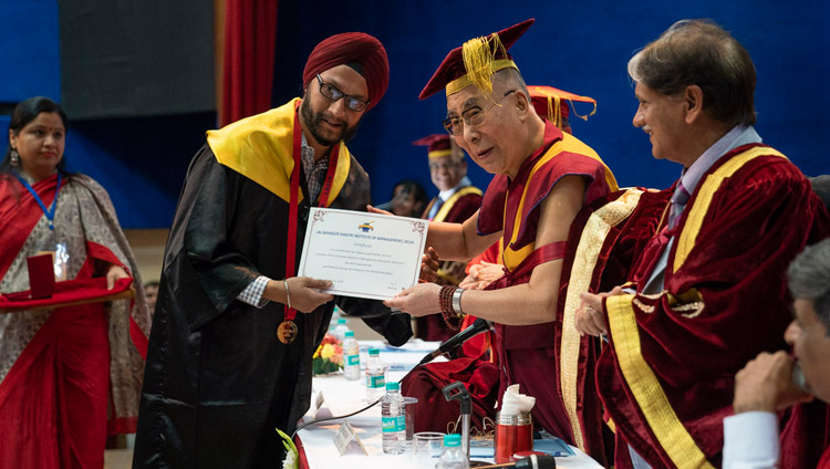 His Holiness the Dalai Lama presenting awards and certificates during the Lal Bahadur Shastri Institute of Management Convocation in New Delhi, India on April 23, 2018. Photo by Tenzin Choejor