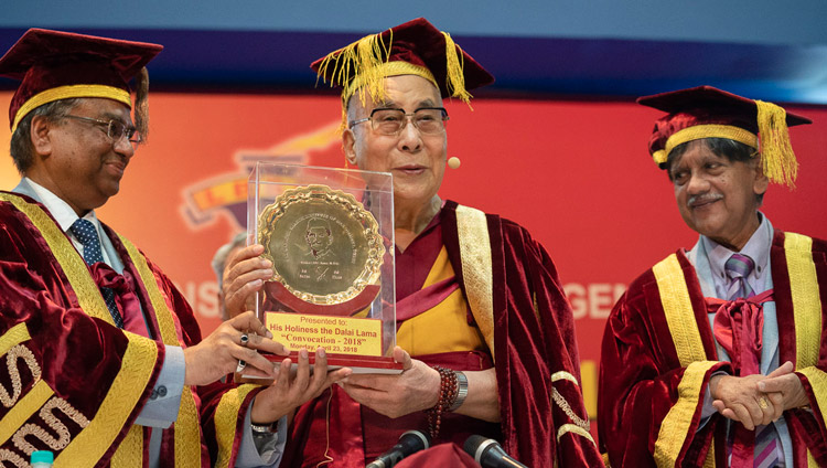 Chairman of the Board of Governors Anil Shastri looks on as LBSIM Director, Dr DK Srivastava offers His Holiness the Dalai Lama a memento of his visit at the conclusion of the Lal Bahadur Shastri Institute of Management Convocation in New Delhi, India on April 23, 2018. Photo by Tenzin Choejor
