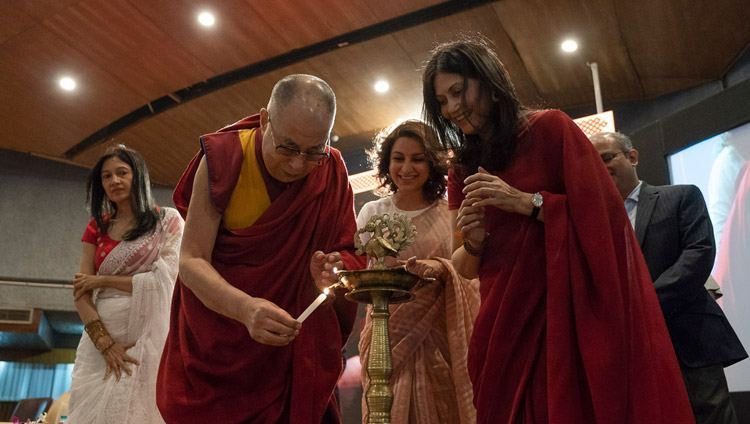 His Holiness the Dalai Lama and his hosts lighting a traditional lamp to open the event at the IIT auditorium in New Delhi, India on April 24, 2018. Photo by Tenzin Choejor