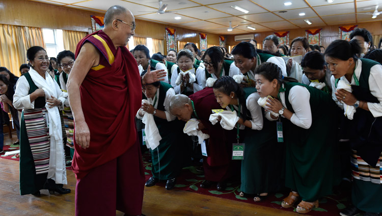 His Holiness the Dalai Lama greeting members of the Tibetan Women's Association as he arrives for their meeting at his residence in Dharamsala, HP, India on May 14, 2018. Photo by Ven Tenzin Damchoe