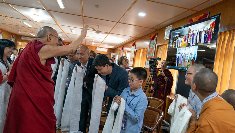 His Holiness the Dalai Lama waving to participants in Hanoi, Ho Chi Minh City and Hai Phong attending a meeting over a live teleconferencing link with a group from Vietnam at his residence in Dharamsala, HP, India on May 21, 2018. Photo by Tenzin Choejor