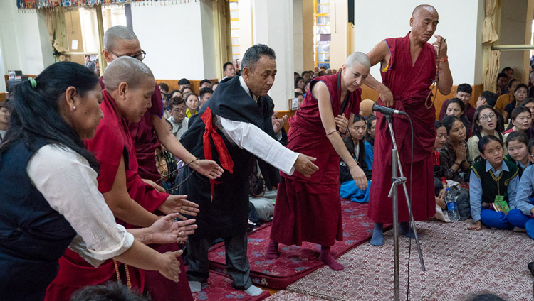 Members of the Dharamsala Buddhist Study Group demonstrating their debating skills at the start of His Holiness the Dalai Lama's teaching for young Tibetan students at the Main Tibetan Temple in  Dharamsala, HP, India on June 6, 2018. Photo by Tenzin Phuntsok