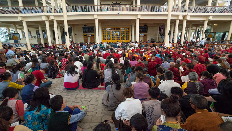 Many of the over 9,000 people attending His Holiness the Dalai Lama's teachings watching on TV screens in the Main Tibetan Temple courtyard in Dharamsala, HP, India on June 6, 2018. Photo by Tenzin Phuntsok