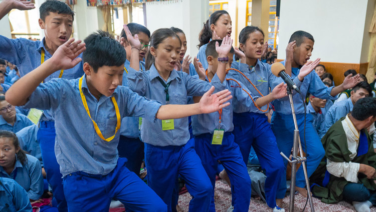 Students from TCV School at Gopalpur demonstrating debate at the start of the second day of His Holiness the Dalai Lama's teaching for young Tibetan students at the Main Tibetan Temple in Dharamsala, HP, India on June 7, 2018. Photo by Tenzin Phuntsok