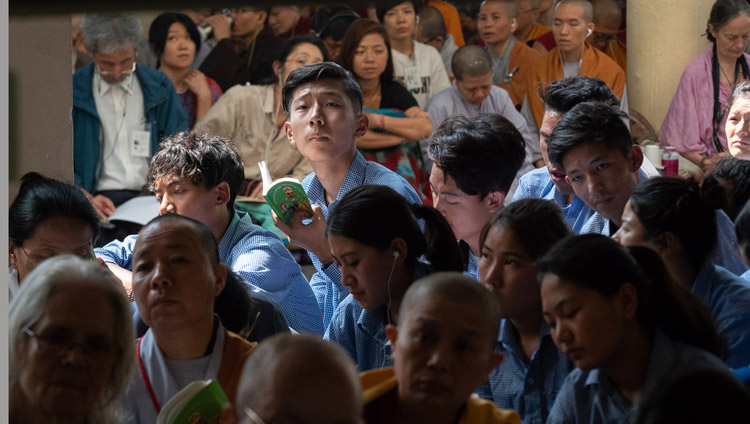Tibetan students sitting on veranda at the Main Tibetan Temple listening to His Holiness the Dalai Lama during the second day of his teaching in Dharamsala, HP, India on June 7, 2018. Photo by Tenzin Phuntsok