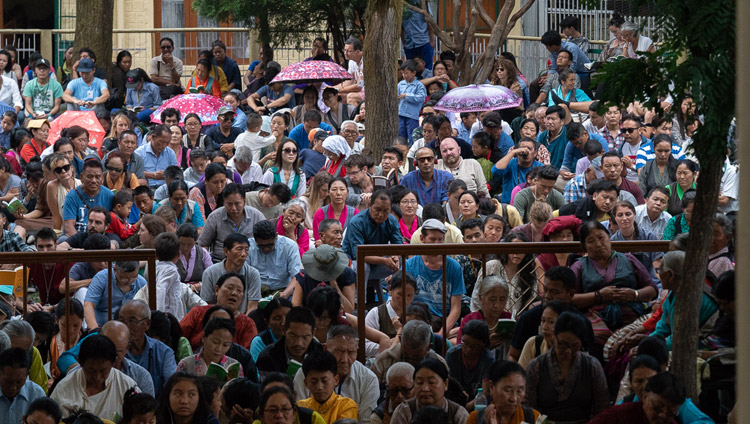 Some of the more than 9000 people attending His Holiness the Dalai Lama's teaching for young Tibetan students sitting in the Main Tibetan Temple courtyard in Dharamsala, HP, India on June 7, 2018. Photo by Tenzin Phuntsok