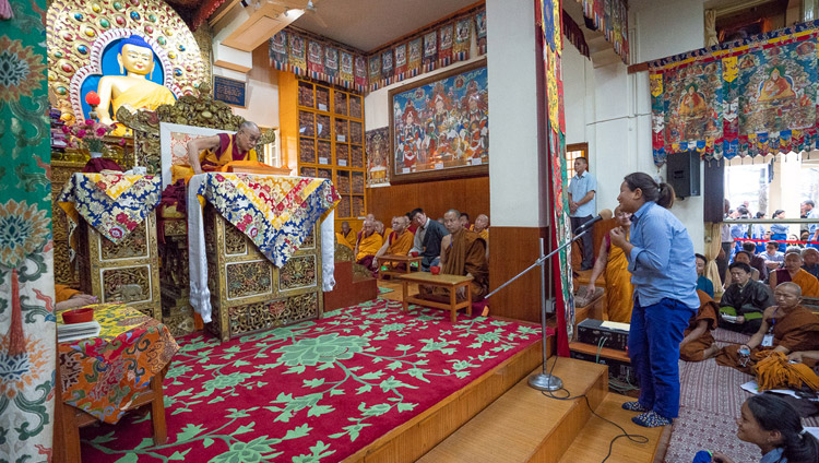 A student asking His Holiness the Dalai Lama a question during a break on the second day of teachings for young Tibetan students at the Main Tibetan Temple in Dharamsala, HP, India on June 7, 2018. Photo by Tenzin Phuntsok