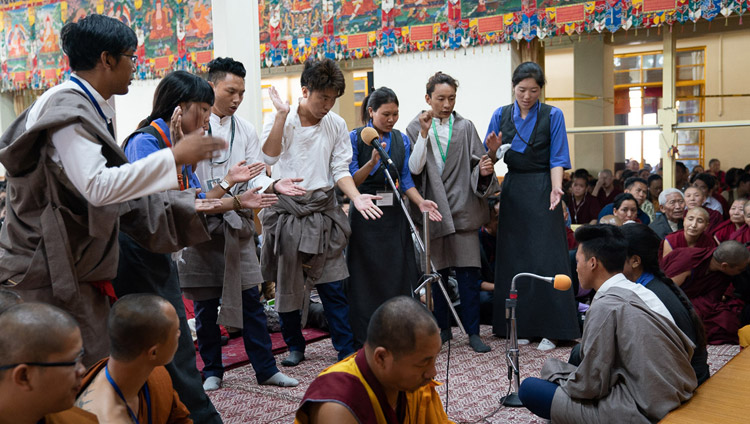 Students from Sherab Gatsel Lobling, the Tibetan Transit School, demonstrating debate on the final day of His Holiness the Dalai Lama's teachings for young Tibetan students at the Main Tibetan Temple in Dharamsala, HP, India on June 8, 2018. Photo by Tenzin Choejor