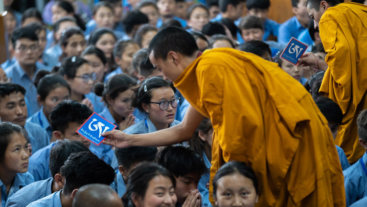 Assistants moving among the audience with ritual objects as His Holiness the Dalai Lama gives the the White Manjushri permission on the final day of his teachings for young Tibetan students at the Main Tibetan Temple in Dharamsala, HP, India on June 8, 2018. Photo by Tenzin Choejor