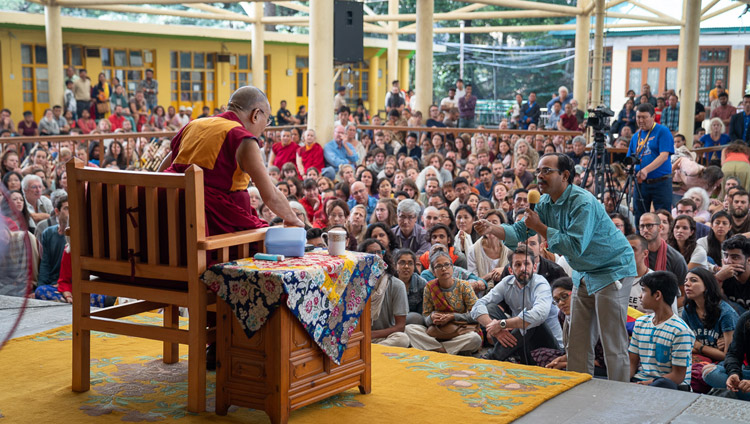 A member of the audience asking His Holiness the Dalai Lama a question during his meeting with visitors from India and abroad at the Main Tibetan Temple courtyard in Dharamsala, HP, India on June 9, 2018. Photo by Tenzin Choejor