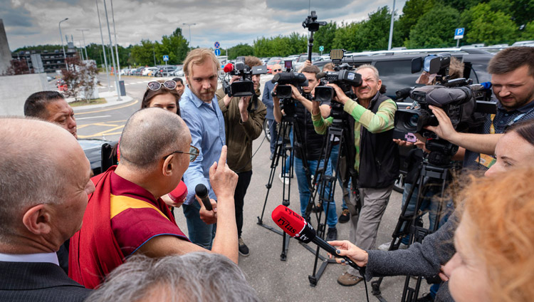 His Holiness the Dalai Lama answering questions from journalists at the airport in Vilnius, Lithuania on June 12, 2018. Photo by Tenzin Choejor