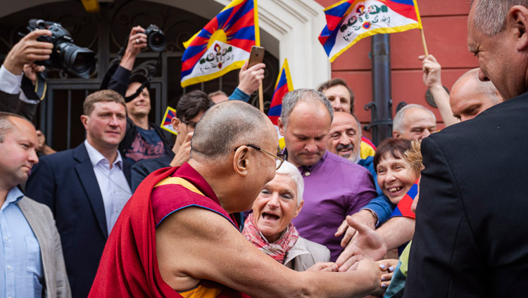 Friends and supporters welcoming His Holiness the Dalai Lama as he arrives at his hotel in Vilnius, Lithuania on June 12, 2018. Photo by Tenzin Choejor