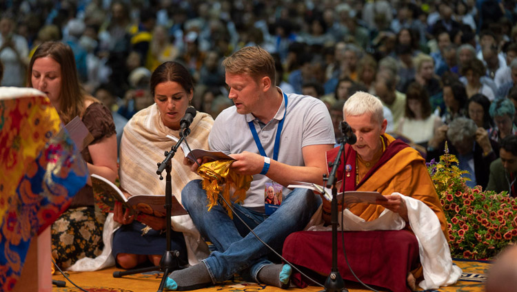 A group from Latvia reciting the 'Heart Sutra' in Latvian at the start of His Holiness the Dalai Lama's teaching in Riga, Latvia on June 16, 2018. Photo by Tenzin Choejor