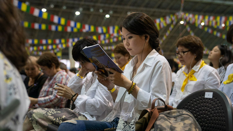 Members of the audience reading the texts along with His Holiness the Dalai on the second day of his three day teaching in Riga, Latvia on June 17, 2018. Photo by Tenzin Choejor