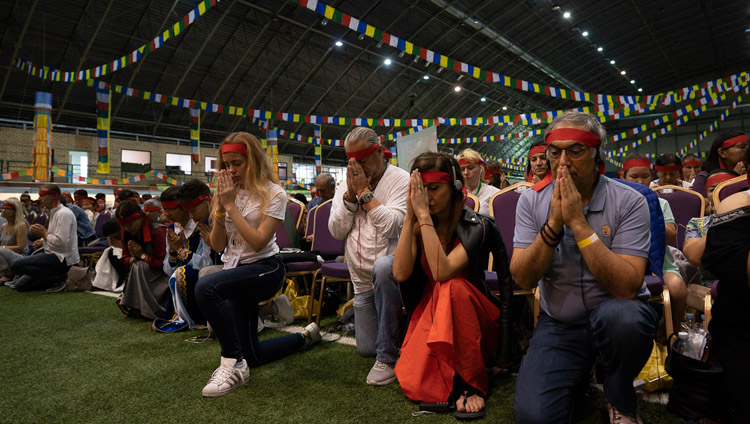 Members of the audience wearing ritual blindfolds taking part in the Avalokiteshvara Empowerment given by His Holiness the Dalai Lama in Riga, Latvia on June 18, 2018. Photo by Tenzin Choejor