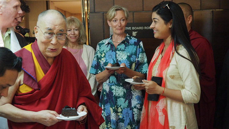 His Holiness the Dalai Lama sharing a birthday cake presented in honor of his upcoming 83rd birthday after his interview for Dutch TV in New Delhi, India on July 2, 2018. Photo by Jeremy Russell