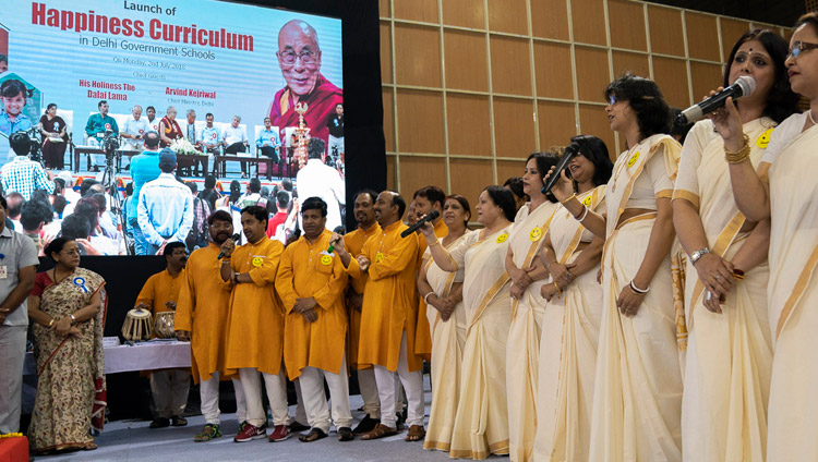 A group of teachers singing a welcome song that they composed themselves at the start of the Launch of the Happiness Curriculum in Delhi Government Schools in New Delhi, India on July 2, 2018. Photo by Tenzin Choejor