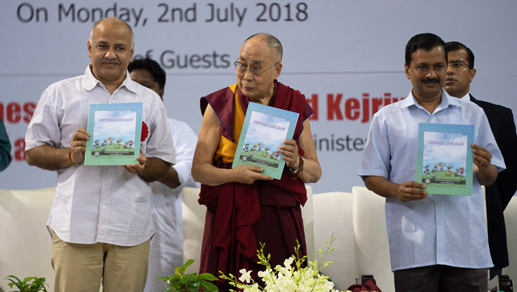 Delhi Deputy Chief Minister Manish Sisodia, His Holiness the Dalai Lama and Delhi Chief Minister Arvind Kejriwal releasing the Happiness Curriculum in Delhi Government Schools in New Delhi, India on July 2, 2018. Photo by Tenzin Choejor