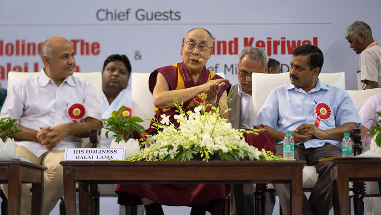 His Holiness the Dalai Lama answering questions from the audience during his talk at the Launch of the Happiness Curriculum in Delhi Government Schools in New Delhi, India on July 2, 2018. Photo by Tenzin Choejor