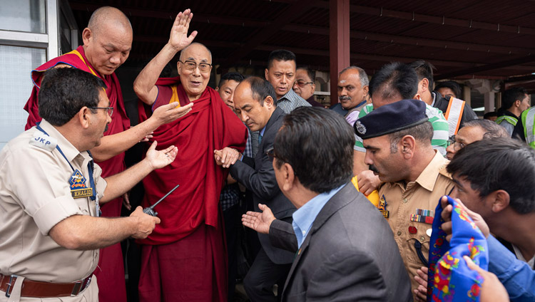 His Holiness the Dalai Lama waving to well-wishers on his arrival at the airport in Leh, Ladakh, J&K, India on July 3, 2018. Photo by Tenzin Choejor