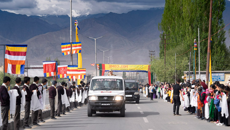 Well-wishers line the road to welcome His Holiness the Dalai Lama as his motorcade makes its way from the airport to his residence in Leh, Ladakh, J&K, India on July 3, 2018. Photo by Tenzin Choejor
