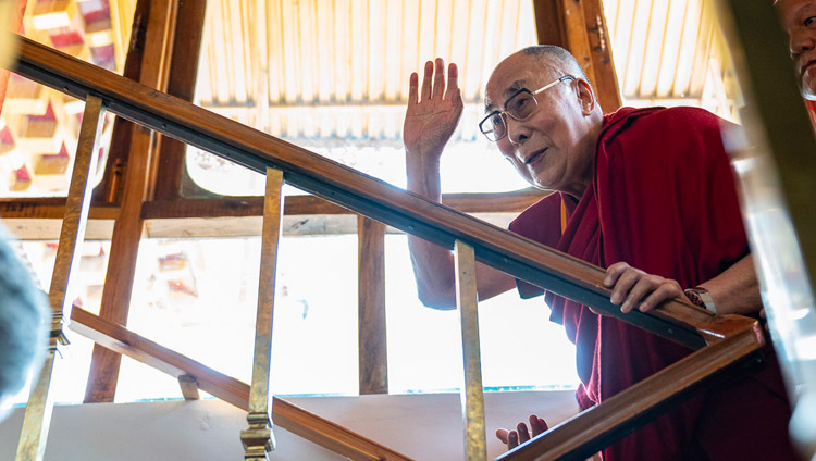 His Holiness the Dalai Lama waving to the gathered guests as he climbs the stairs to his residential quarters in Leh, Ladakh, J&K, India on July 3, 2018. Photo by Tenzin Choejor