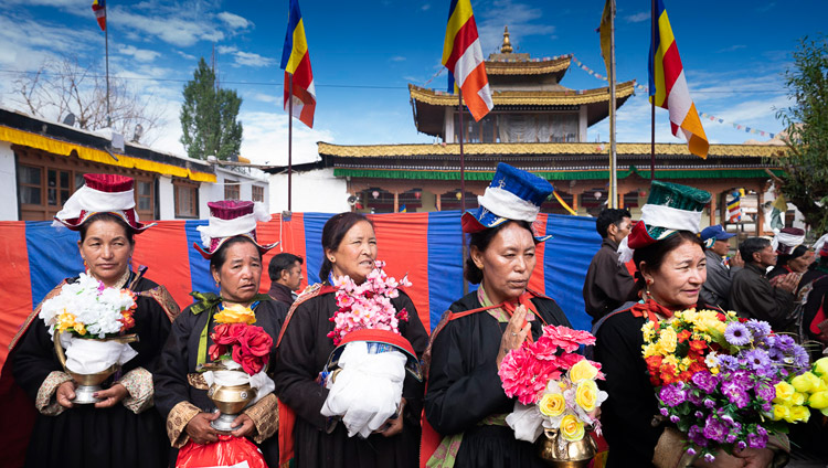 Women in traditional dress waiting for His Holiness the Dalai Lama to arrive at the Jokhang in Leh, Ladakh, J&K, India on July 4, 2018. Photo by Tenzin Choejor