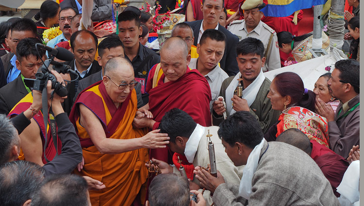His Holiness the Dalai Lama interacting with members of the crowd gathered outside the Leh Jokhang as he prepares to depart for his residence in Leh, Ladakh, J&K, India on July 4, 2018. Photo by Jeremy Russell