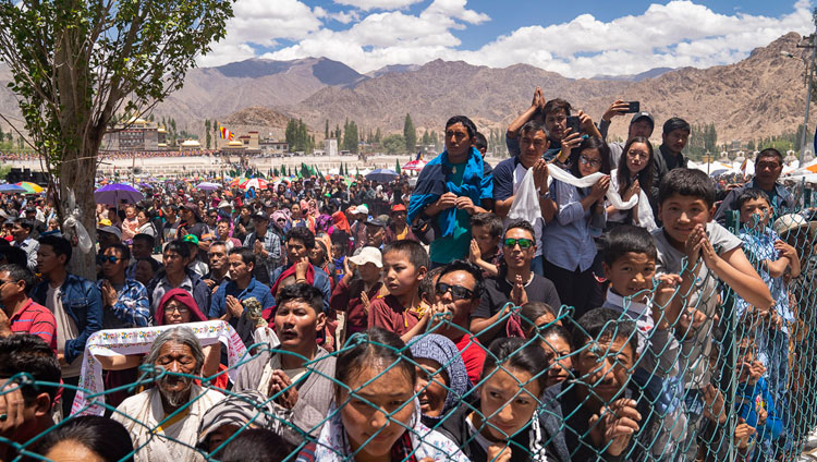 Members of the crowd line the road hoping to catch a glimpse of His Holiness the Dalai Lama as he returns to his residence at the conclusion of celebrations on his 83rd birthday in Leh, Ladakh, J&K, India on July 6, 2018. Photo by Tenzin Choejor