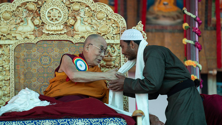 His Holiness the Dalai Lama thanking President of the Nubra Valley Muslim community, Muhammad Akram for his speech at the Inauguration of the Great Summer Debate at Samstanling Monastery in Sumur, Ladakh, J&K, India on July 15, 2018. Photo by Tenzin Choejor