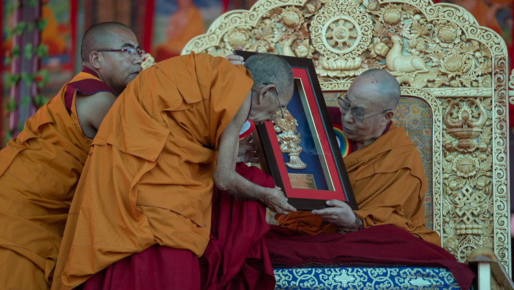 Ganden Trisur, Rizong Rinpoche, presenting His Holiness the Dalai Lama with a memento of the Inauguration of the Great Summer Debate at Samstanling Monastery in Sumur, Ladakh, J&K, India on July 15, 2018. Photo by Tenzin Choejor