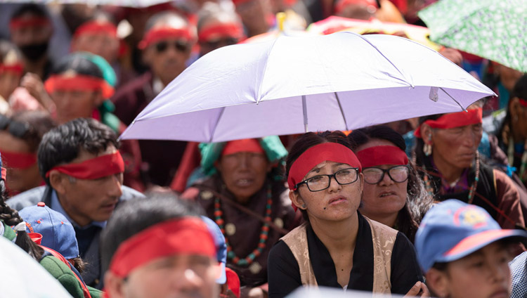 Some members of the audience using umbrellas to protect against the sun during the Avalokiteshvara empowerment given by His Holiness the Dalai Lama in Padum, Zanskar, J&K, India on July 23, 2018. Photo by Tenzin Choejor
