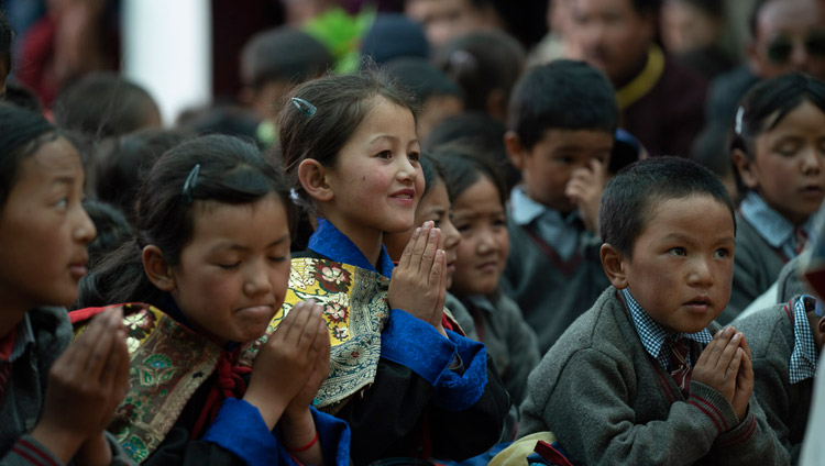 Students reciting the 'Praise to Manjushri' with His Holiness the Dalai Lama during his visit to Lamdon Model School in Padum, Zanskar, J&K, India on July 24, 2018. Photo by Tenzin Choejor