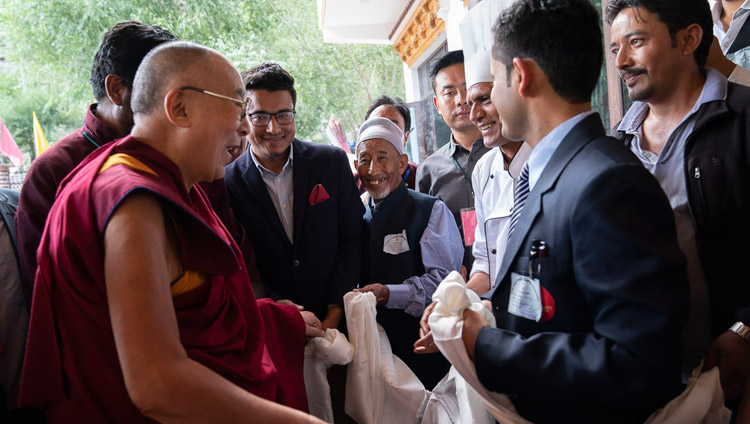 His Holiness the Dalai Lama thanking staff at his hotel after lunch on his first day in Kargil, Ladakh, J&K, India on July 25, 2018. Photo by Tenzin Choejor